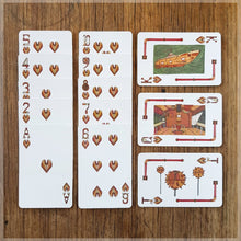 Hand Illustrated Steampunk playing cards showing the suit of hearts. The picture cards show the cockpit, its weapons and the full ship.