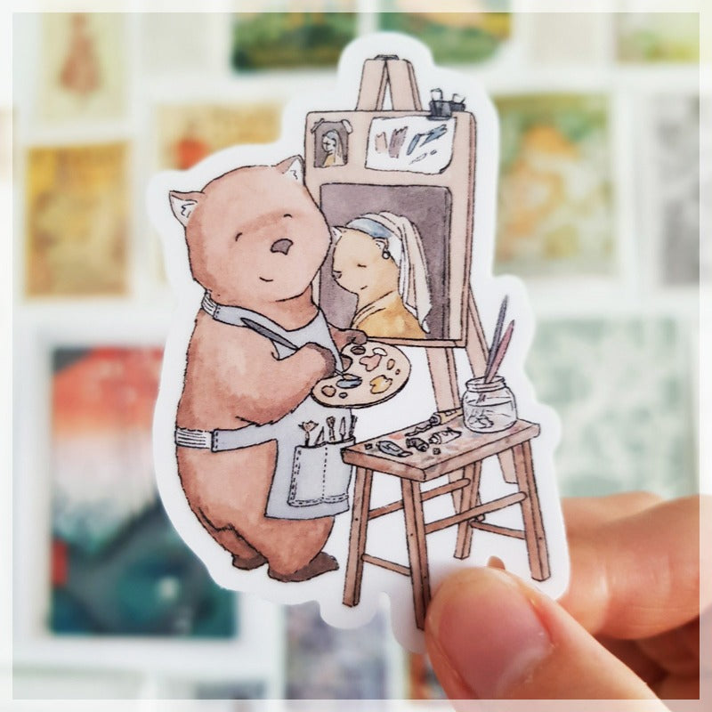 A gentle and serene wombat paints 'Girl with the pearl earring' as a tribute to one of her favorite artists.