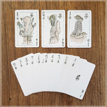 Hand Illustrated vogue fashion playing cards showing the suit of clubs.