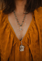 Brown and White Bucking Horse Necklace Set