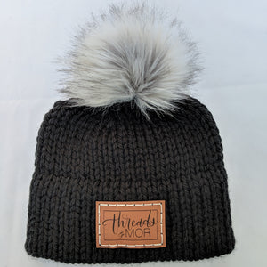 Black double brim knit hat with silver fox faux fur pompom