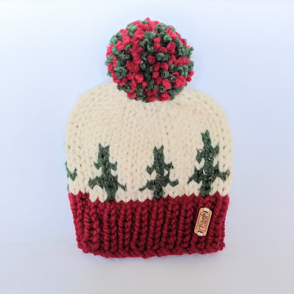 Holiday Spirit knit hat with yarn pompom