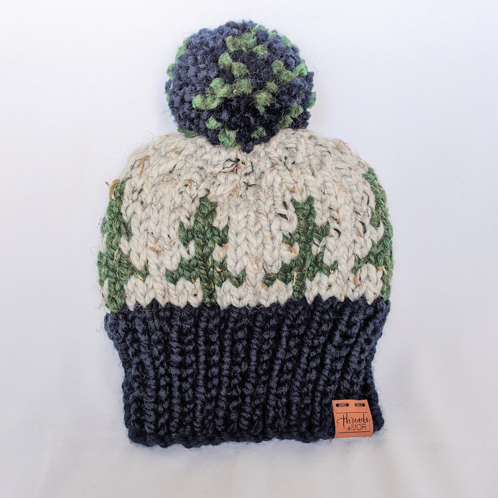 Evergreen knit beanie hat with yarn pompom