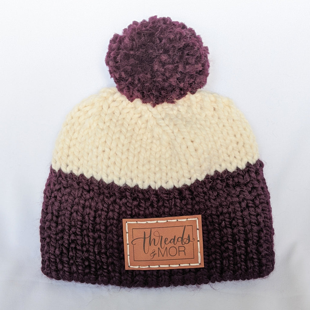 Eggplant and cream double brim knit hat with yarn pompom