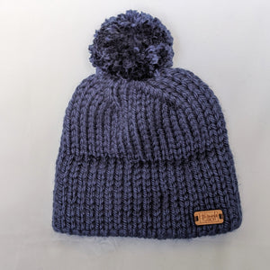 Navy double brim knit hat with yarn pompom