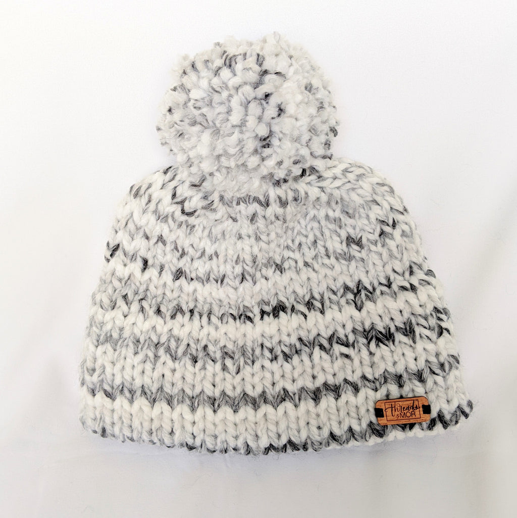 White and gray stripped double brim knit hat with yarn pompom