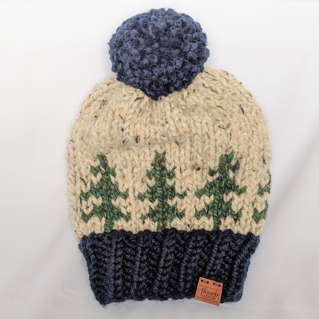 Evergreen slouchy knit hat with yarn pompom