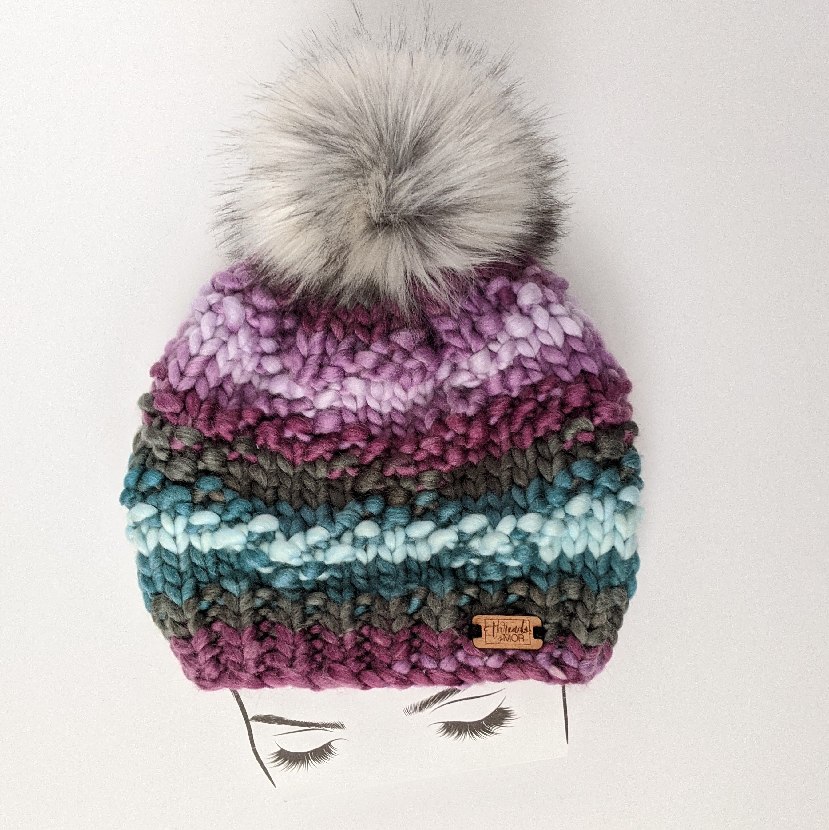Etta Dreamsicle Stripped Knit Beanie Hat with extra large faux fur pom pom