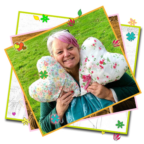 Pauline Giles with post-surgery support heart shaped cushions