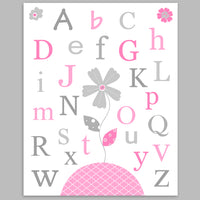 Alphabet nursery print with flowers in pink and grey.