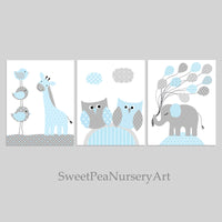 Three grey and baby blue nursery art prints with birds, owls, a giraffe, and an elephant