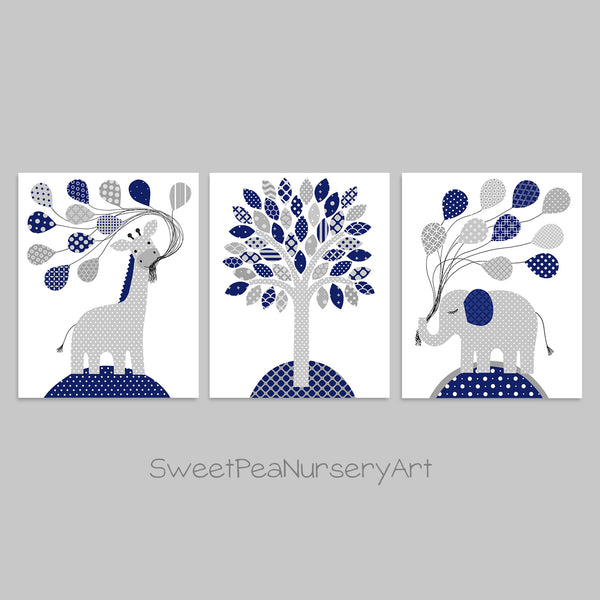 Set of three grey and navy baby art prints with an elephant, giraffe and tree.
