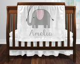 baby blanket with baby's name and gray and pink elephant holding balloons