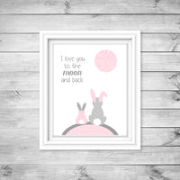 Bunny nursery art print of two rabbits under the moon and the words I love you to the moon and back in baby pink and grey.
