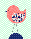 Nursery art print of a coral bird with navy accents on mint chevron background.