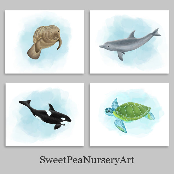 Set of four watercolor nautical creature nursery decor including a manatee, orca, sea turtle and dolphin.