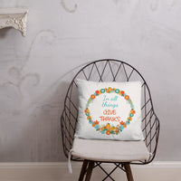 Christian pillow with scripture saying In all things give thanks inside a fall wreath with leaves and pumpkins