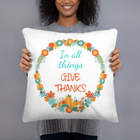 beautiful autumn pillow featuring a Bible verse In all things give thanks and a fall wreath with leaves and pumpkins