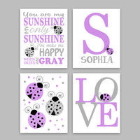 Set of four grey and purple ladybug nursery art prints with monogram