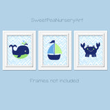 Set of three coastal nursery pictures with a whale, crab and sailboat in blue, green and navy.