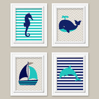 Nautical baby decor with a whale, seahorse, dolphin and sailboat in beige, navy and teal
