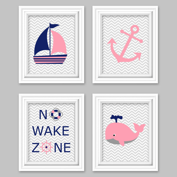 Pink and navy nautical nursery pictures including a whale, sailboat, anchor and No Wake Zone.