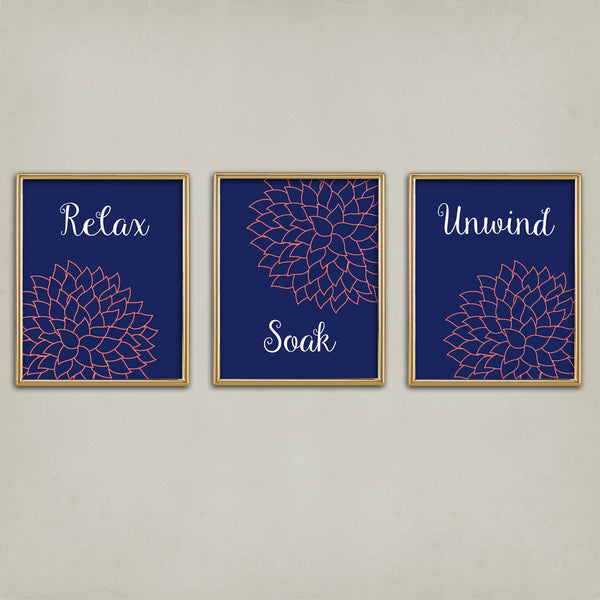 Set of three bathroom art prints in navy and coral with the words Relax, Soak and Unwind.