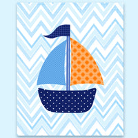 nautical nursery print with a blue, orange and navy sailboat on light blue chevron.