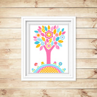 aqua, pink and orange tree nursery print shown in frame on wooden wall