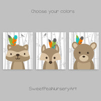 set of three nursery art prints with a fox, raccoon and bear in tribal feathers