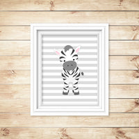 zebra on striped background nursery print in frame on wall