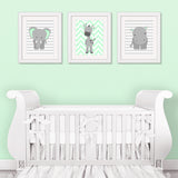 zoo animal prints on wall in gray and mint