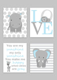 Set of four zoo nursery prints featuring an elephant on stripes, a hippo on large polka dots, a print that says LOVE with a lion sleeping, and a print with the song lyrics to You Are My Sunshine with a giraffe, all in baby blue and shades of gray.