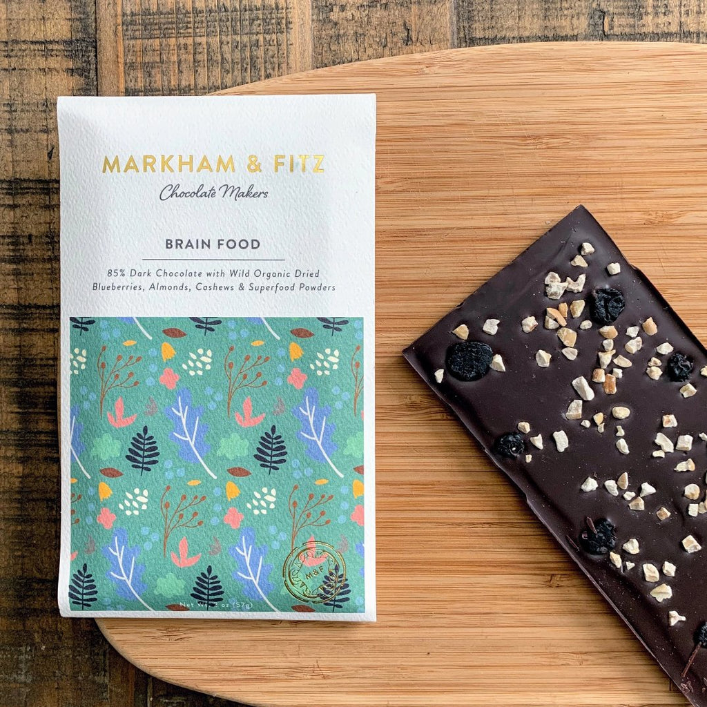 Nuts and cherries blend brilliantly into this dark Craft Chocolate bar that has a festive packaging featuring the outdoors.