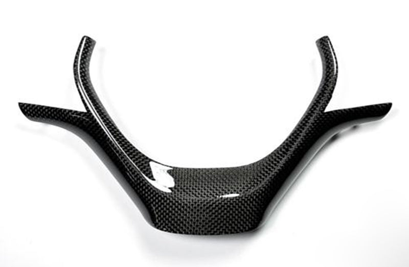 bmw steering wheel carbon fiber trim on white background