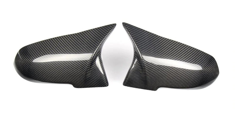 carbon fiber mirror caps on white background