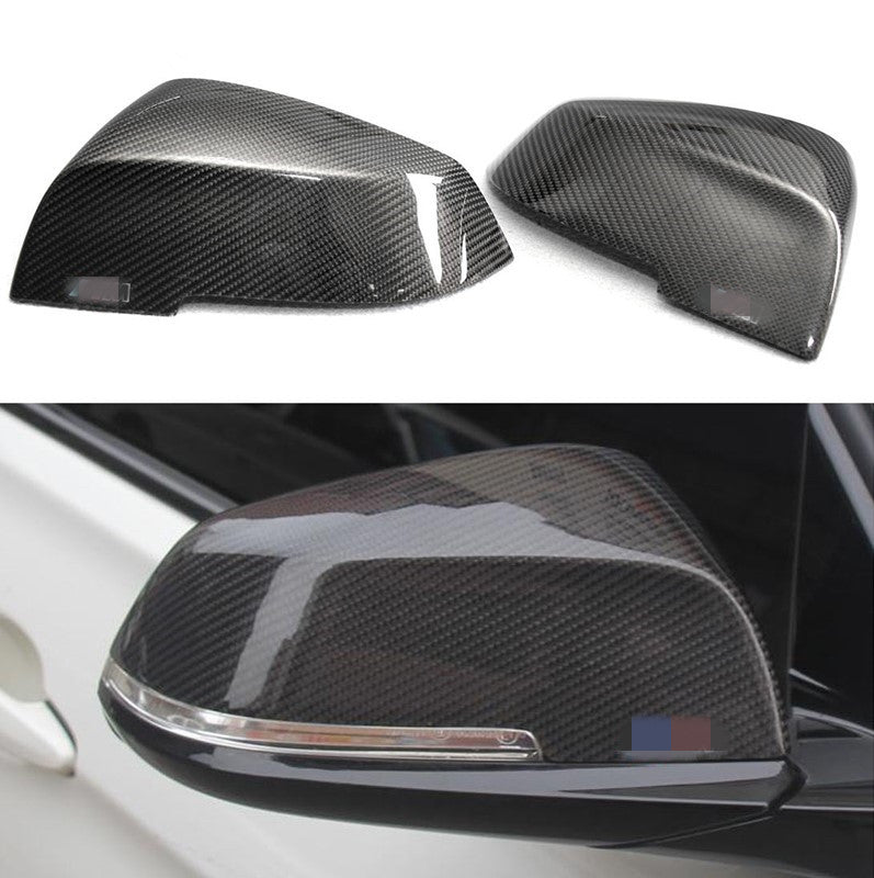 carbon fiber mirror caps for bmw on a white background and installed