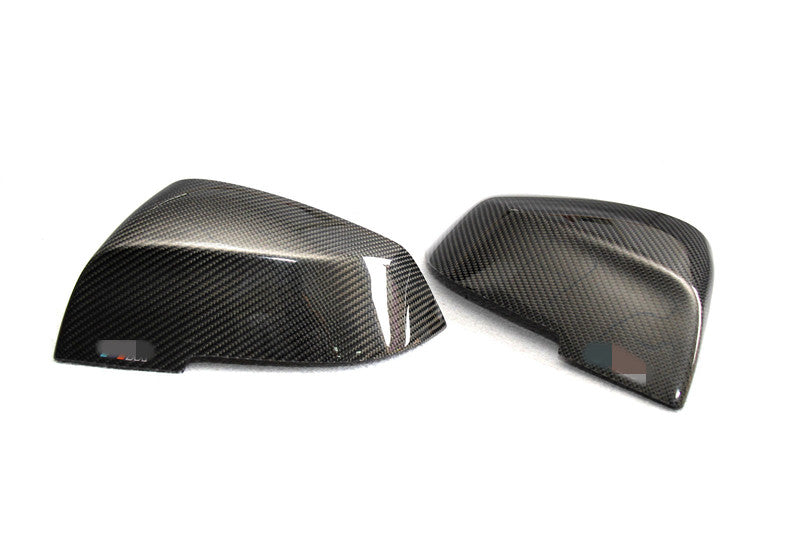 carbon fiber mirror caps for bmw on a white background
