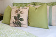 Green Bed with Botanical Pillow