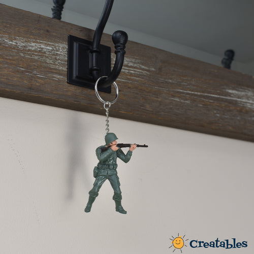 green soldier shooting gun from shoulder height