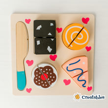 Load image into Gallery viewer, wooden cutting toy with 4 pieces of baked goods and a wooden knife