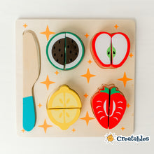 Load image into Gallery viewer, wooden cutting toy with 4 fruit pieces and a wooden knife on a quare trays decorated with orange stars