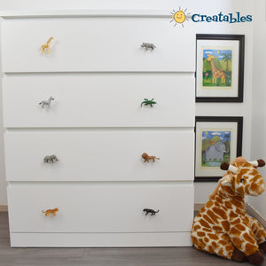 white dresser with 4 drawers and two safari knobs on each