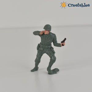 soldier calling out holding a small gun figurine on white background