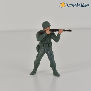 Army figurine shooting gun at shoulder height