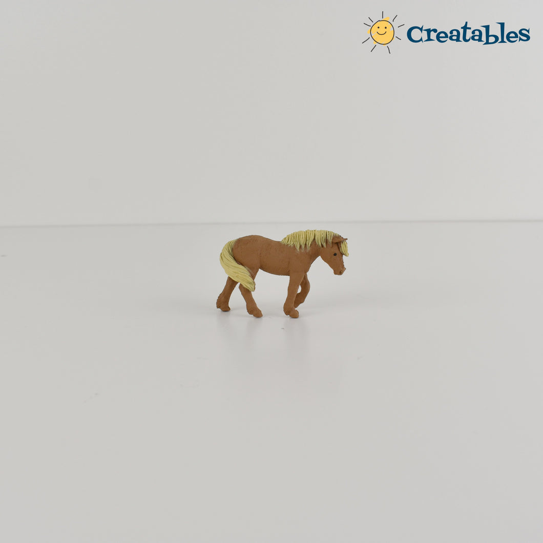 Light Brown pony knob side view with blonde mane on white background