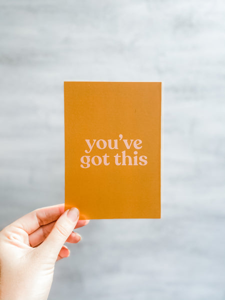 "This is an image of our 'You've Got This"" Mini Postcard. It's an A6 postcard that can be added to your flower delivery, and features ballet pink text in all lowercase on a turmeric yellow background."