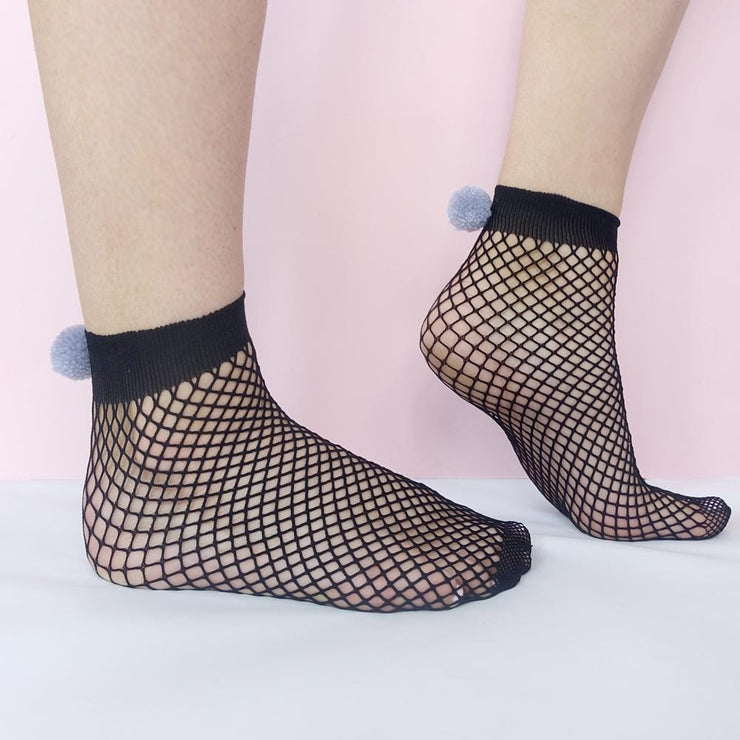 Black fish net socks with grey pom poms