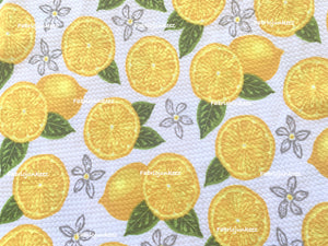 Bullet Textured Lemons Poly Spandex Fabric