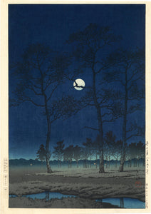 Hasui: Winter Moon over Toyama Plain. Magnificent view of trees silhouetted against the winter moon.